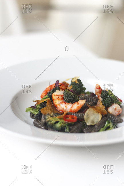 High angle view of squid ink pasta with seafood and vegetables