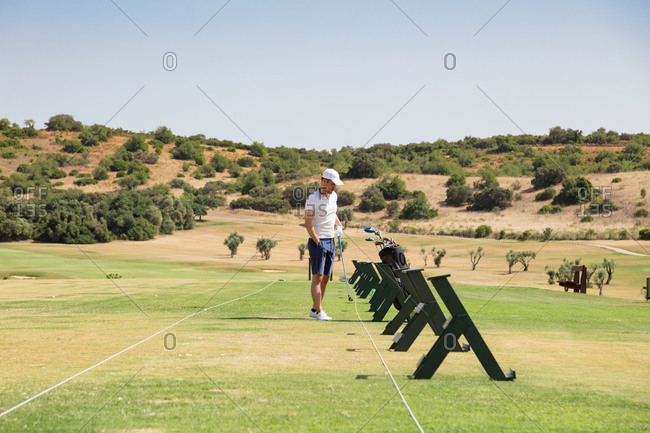 Man on golf driving range in nature