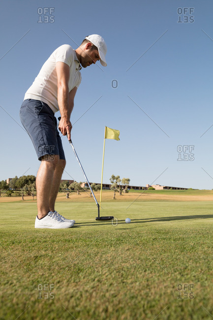 Golfer hitting a golf shot in the golf course