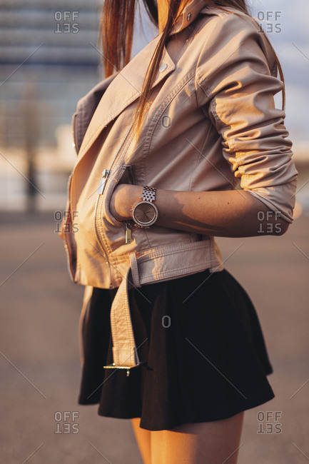 Middle side view of urban fashion model standing in sunset light