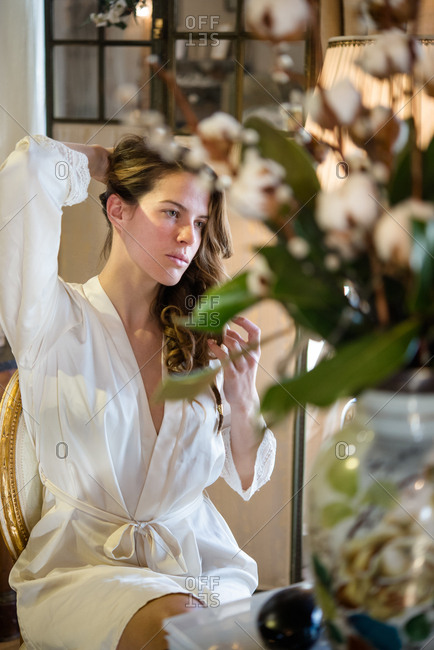 Bride in dressing gown on morning of wedding