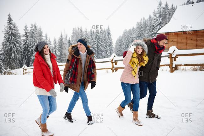 Friends walking in snow