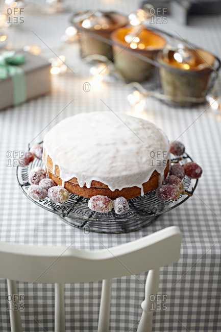 Iced cake on table with decorative lights