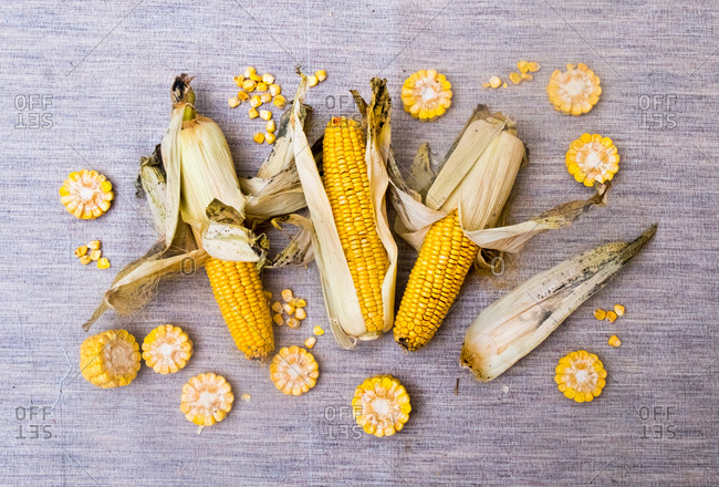 Corn on the cob with slices of corn, overhead view