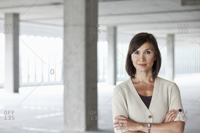 Caucasian businesswoman in a large empty raw office space