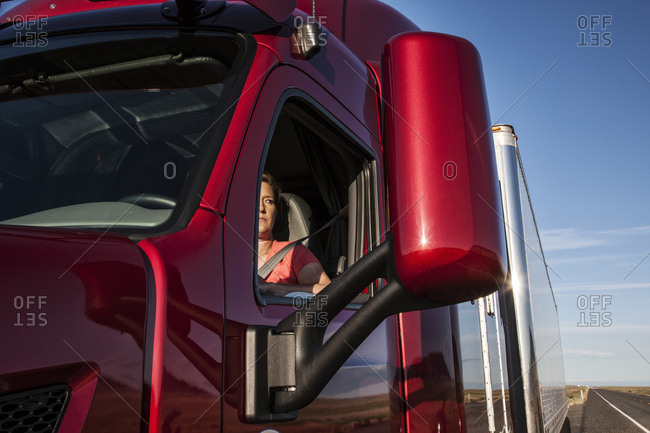 View of a Caucasian woman driver in the cab of her  commercial truck