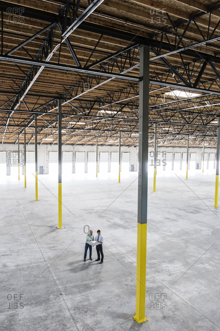 Team of people checking out the new interior of an empty warehouse space