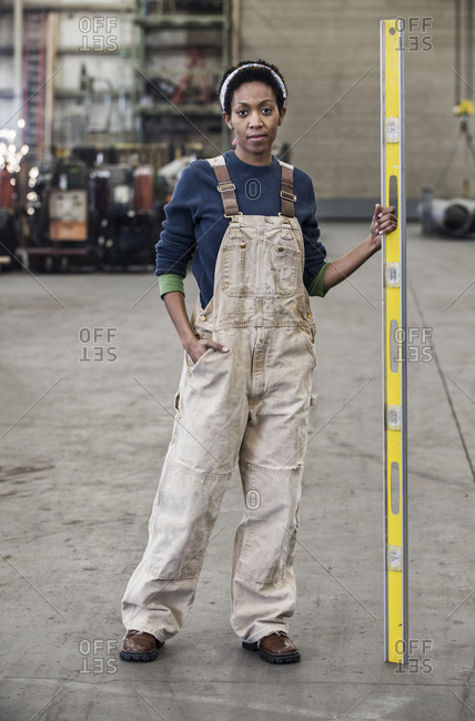 Black woman factory worker standing on the floor of a sheet metal factory