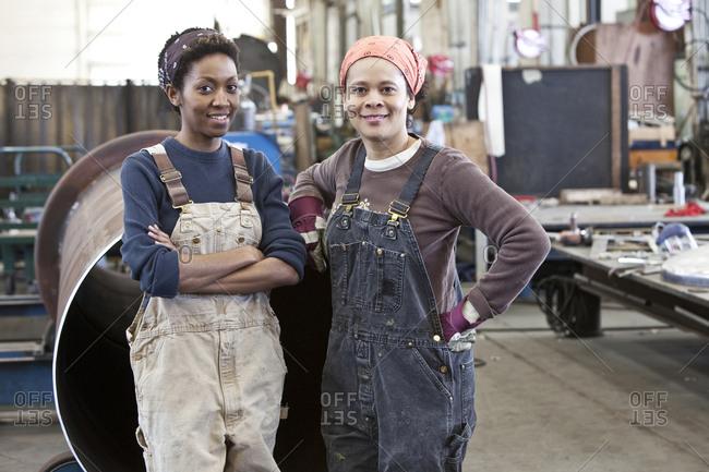 Black women team of factory workers in a sheet metal factory