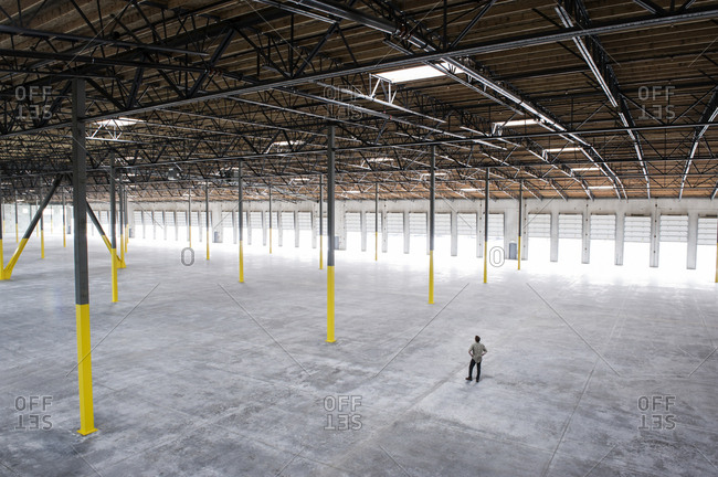 Owner checking out the new interior of a large empty warehouse space