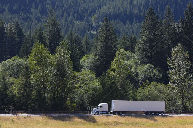 Commercial truck on a highway in the mountains east of Seattle, Washington USA