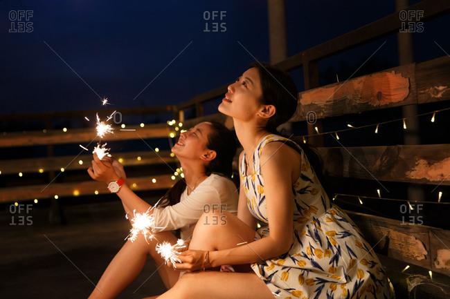 Two young women set off fireworks