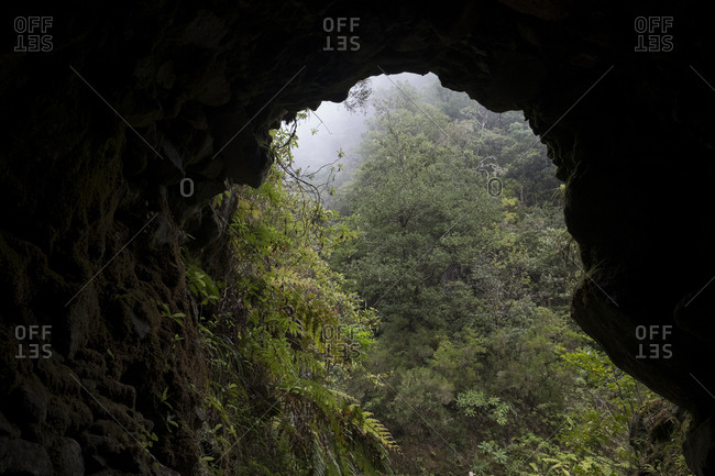 View through dark tunnel on Pinaculo and Folhadal trek