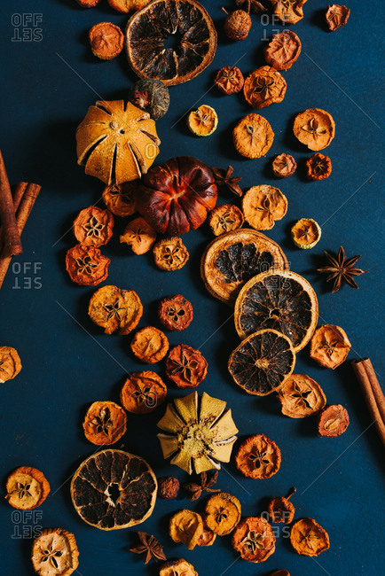 Different dry citrus fruit on a blue background