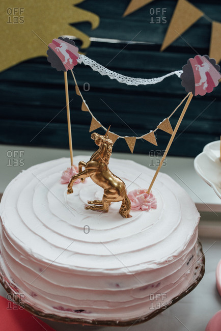 Birthday Cake Decorated With Golden Unicorn For Themed Party Stock Photo