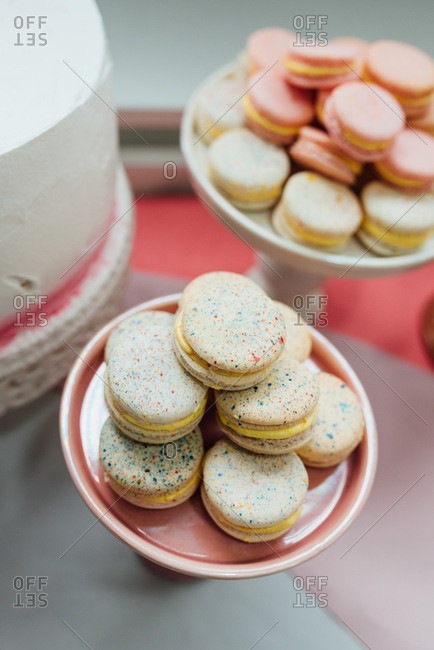 Macaroons on a pink and white  plate