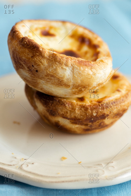 Close up of traditional portuguese dessert pasteis de belem - baked puff pastry with custard
