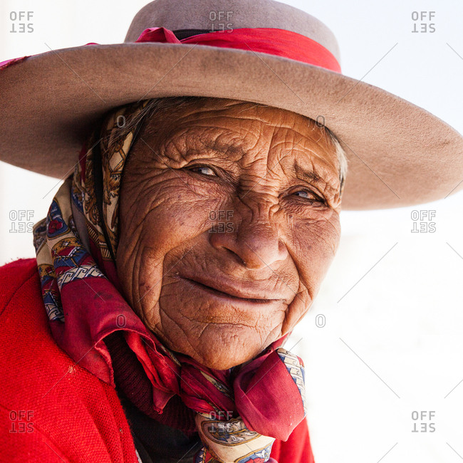San Antonio de los Cobres, Argentina - November 17, 2011: A smiling elderly woman with a traditional hat