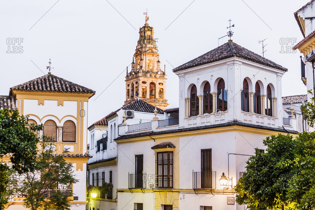 Typical Andalusian architectures with the bell tower of the Mosque Cathedral of Cordoba, Andalusia, Cordoba, Spain