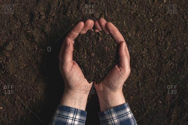 Farmer holding dirt in hands