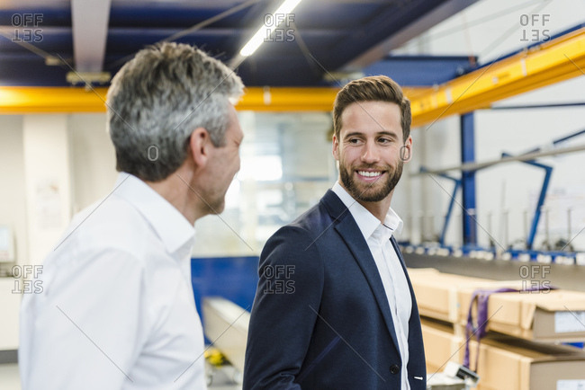 Smiling managers in a production hall