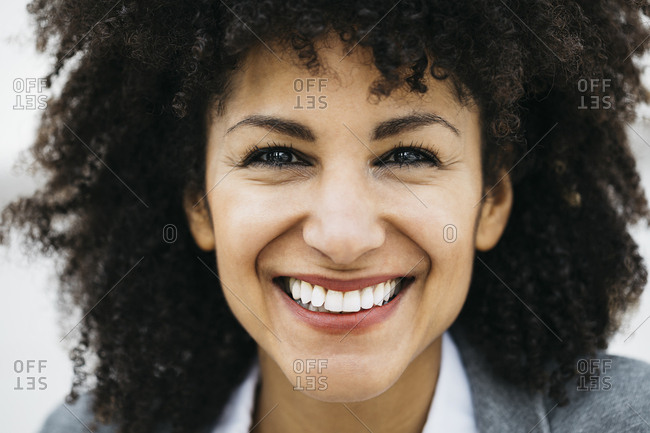 Portrait of happy woman with curly hair