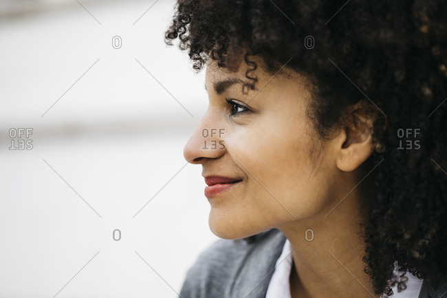 Profile of smiling woman with curly hair