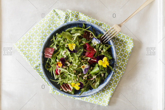 Bowl with salad- lamb's lettuce- rucola- radicchio and edible flowers