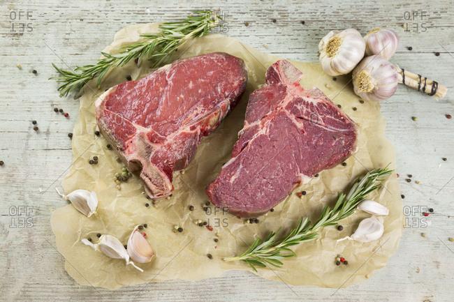 Raw dry-aged T-bone steaks
