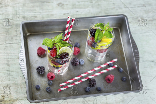 Infused water with fresh berries- raspberry- blueberry- blackberry- mint and lime