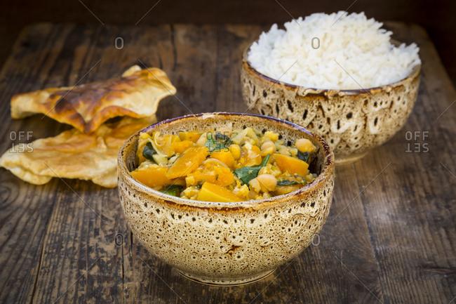 Curry dish with cauliflower- butternut pumpkin- spinach and coriander- papadam and rice