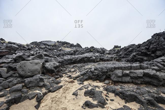 Weathered basalt rock formation off the beach at Skardsvik, Iceland