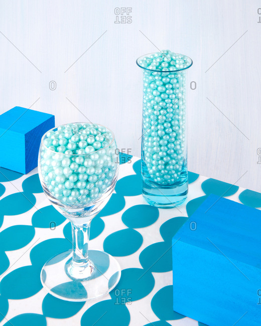 Still life of shiny balls of candy served in glassware
