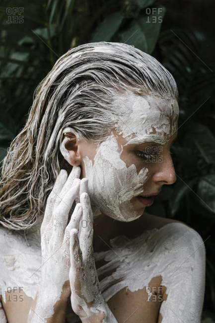 Close up of a woman with white paint all over her body
