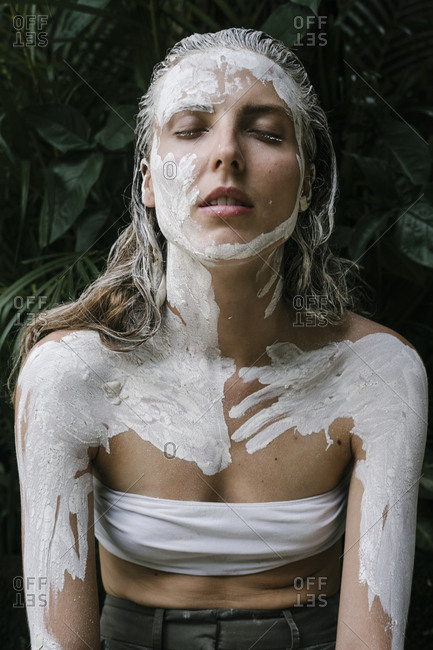 Woman with white paint smeared on her body