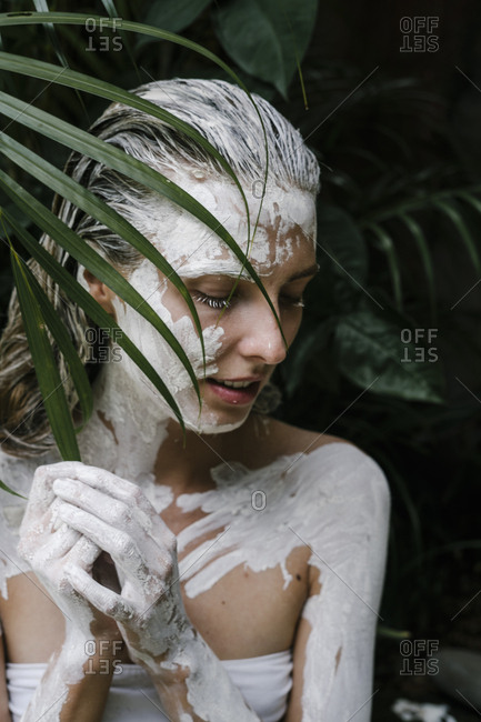 Woman with white paint all over her body