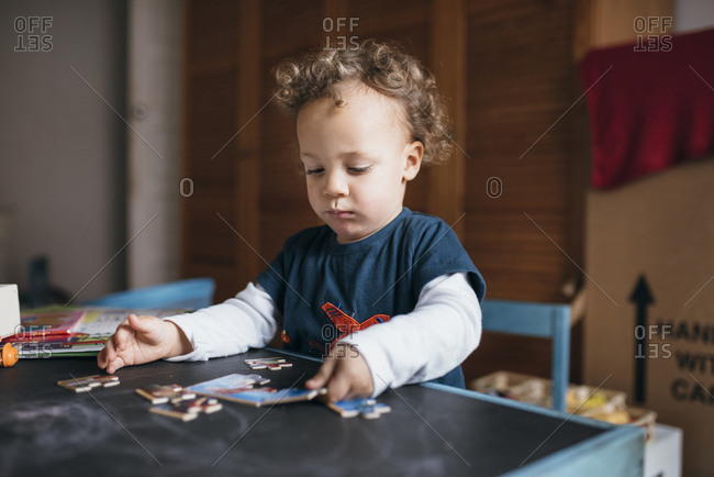 Boy concentrating on jigsaw puzzle