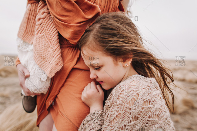 A little girl embracing her mother