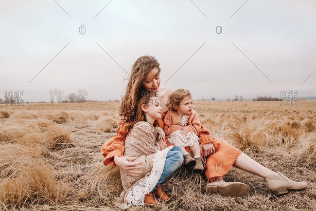 A mother embracing her daughters