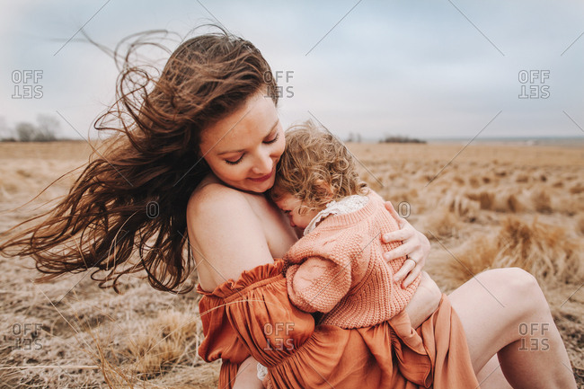 A mother embracing her daughter