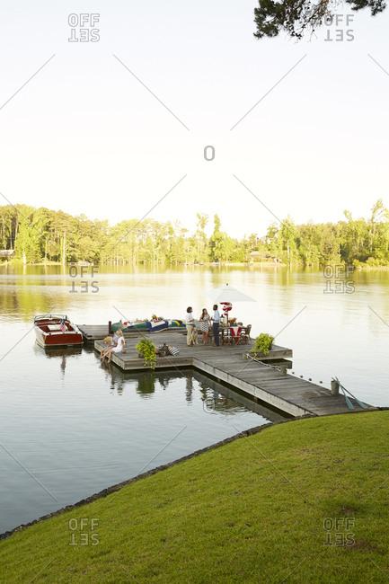 Lake Martin, Georgia - June 22, 2016: Family gathering on scenic lake dock