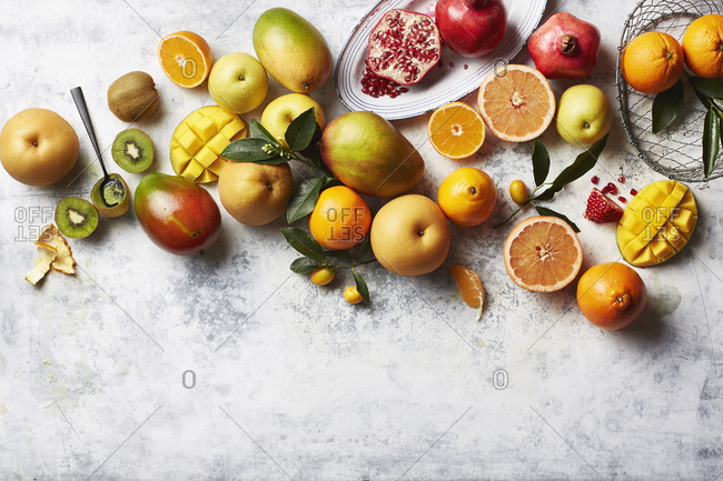 Spread of fruit on distressed marble