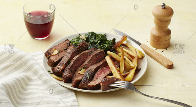 Steak and fries dinner with napkin