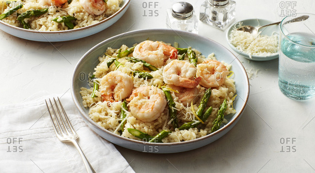 Fresh cooked shrimp risotto with asparagus