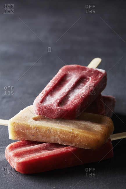 Stack of fruity alcoholic popsicles