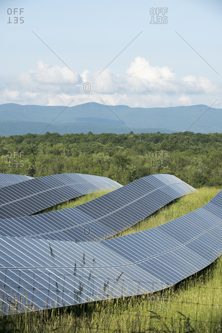 Solar panels in grassy rural Vermont field
