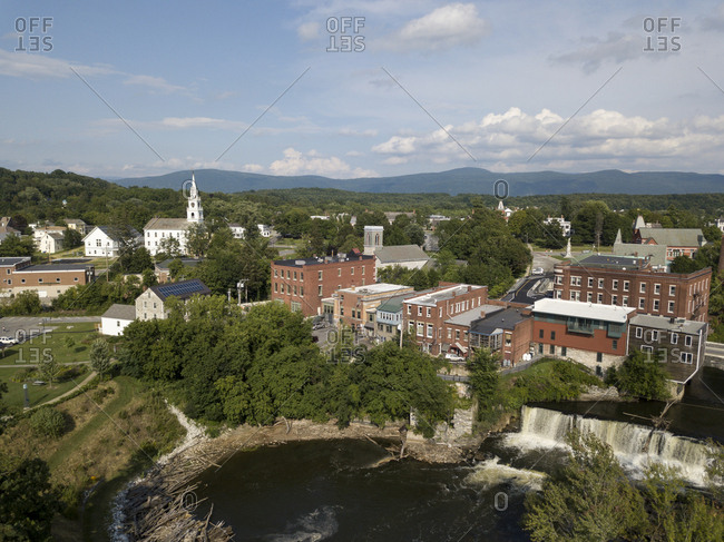 Summer drone view of Middlebury, Vermont between Otter Creek and the Green Mountains