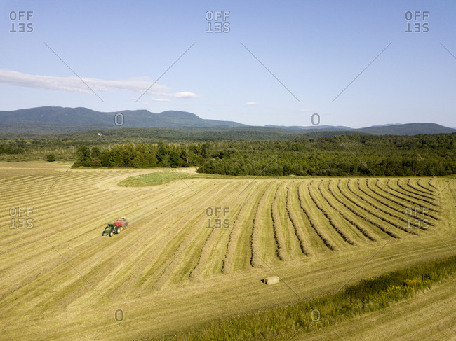 Brandon, Vermont - August 30, 2017: Haying on golden farm field