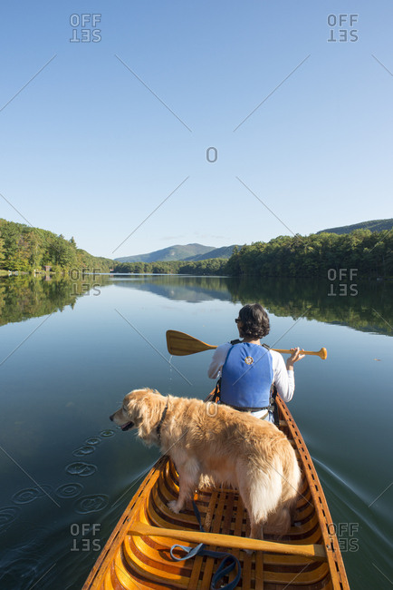 Woman canoeing on Fern Lake with dog