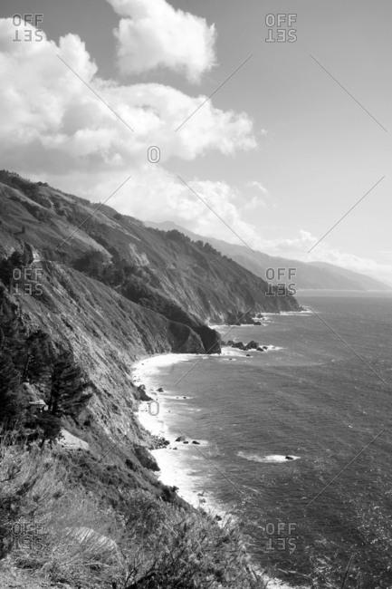 Steep cliffs dropping into the ocean on rugged coastline
